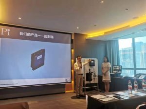 Chen Jiang and Fan Shuxing introducing Pi's products